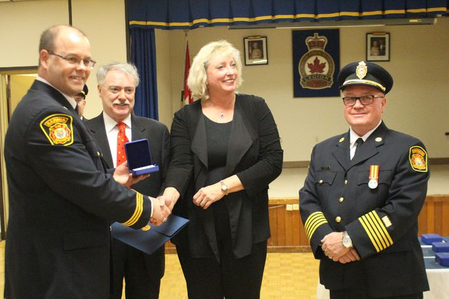 William Sheane, left, was among the recipients of the Governor-General's medal for exemplary service as a firefighter. Presenting the medals are from left Sarnia Mayor Mike Bradley, Sarnia-Lambton MP Marilyn Gladu and Sarnia Fire Chief John Kingyens. (NEIL BOWEN/Sarnia Observer)