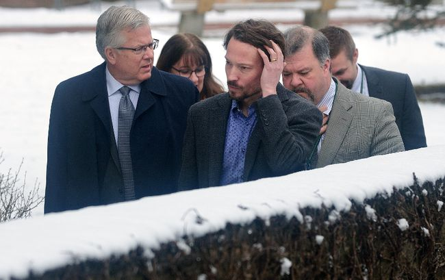 Dr. Chris Mackie, medical officer of health for the Middlesex-London Health Unit, right, walks from his office to the nearby Middlesex County building for a press conference with board member Ian Peer and staffers Laura DiCesare, Dan Flaherty and Jordan Banninga on Wednesday March 7, 2018. MORRIS LAMONT/THE LONDON FREE PRESS /POSTMEDIA NETWORK