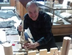 Mike Baker, Elgin County Museum curator, takes aim with mini catapult at a model castle - a hands-on part of the current exhibition of Medieval European life at Elgin County Heritage Centre and one of a number of March break things to see and do in St. Thomas and Elgin. (Eric Bunnell/Times-Journal)