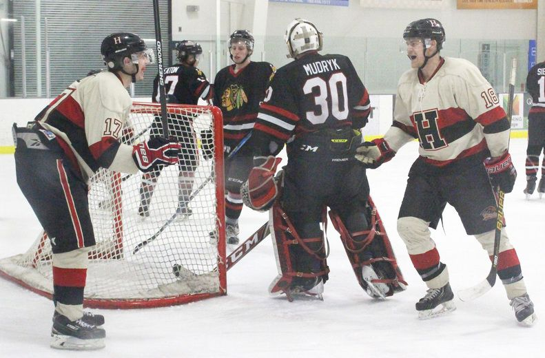 Hawks star forward Tyson Davey, left, celebrates Jesse Morrison's goal against the Beverly Warriors on March 4 at the Clareview Arena. Game 4 returned to the JRC on March 7 where the Hawks saw their first win. The two teams will play again on Friday.
