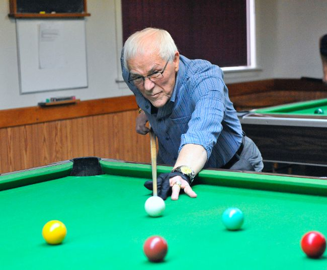 Simcoe Seniors' Centre member Arnold Shaw takes a shot during a billiards game at the facility on Thursday. With their building on Pond St. deemed inadequate for future use, the group is waiting for county council to decide the next course of action. JACOB ROBINSON/Simcoe Reformer