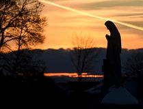 <p>A religious statue is silhouetted in the setting sun at St. John the Baptist Cemetery in Pottsville, Pa., on Tuesday, Feb. 6, 2018. </p><p> Jacqueline Dormer/The Republican-Herald via AP