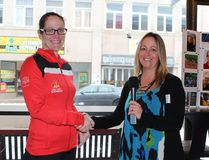 Team Canada Invictus athlete and Canadian Armed Forces veteran Brenda McPeak shakes hands with Community Living Upper Ottawa Valley manager of supports and services Tina Williams (right), following the Women's Day Breakfast on March 8.
