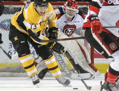 Kingston Frontenacs' Gabe Vilardi looks for the puck in the slot in front of Ottawa 67's goalie Cedrick Andree during first-period Ontario Hockey League action at the Rogers K-Rock Centre on Friday. (Ian MacAlpine/The Whig-Standard)
