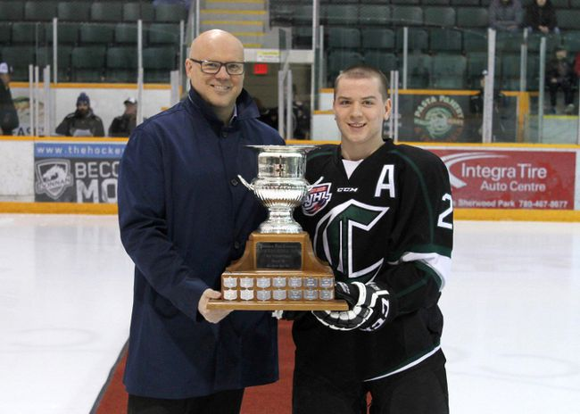 Sherwood Park Crusaders GM Kyle Chase presents Ty Readman with his second MVP trophy is as many seasons.  Photo Supplied