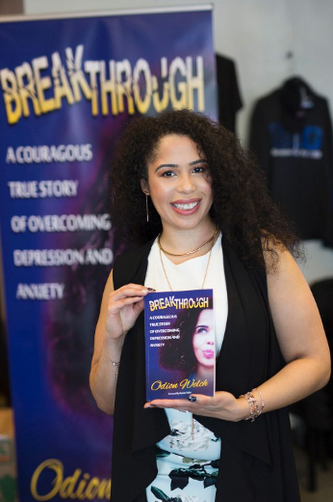 Odion Welch poses with her first book, titled Breakthrough, during an event at Spark Centre in Sherwood Park earlier this month.  Photo courtesy of Cara Photographers