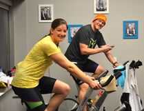Dan O'Neill is joined by Heather Cole in riding a stationary bike for 24 hours straight, benefitting the Kids with Cancer Society. Photo supplied