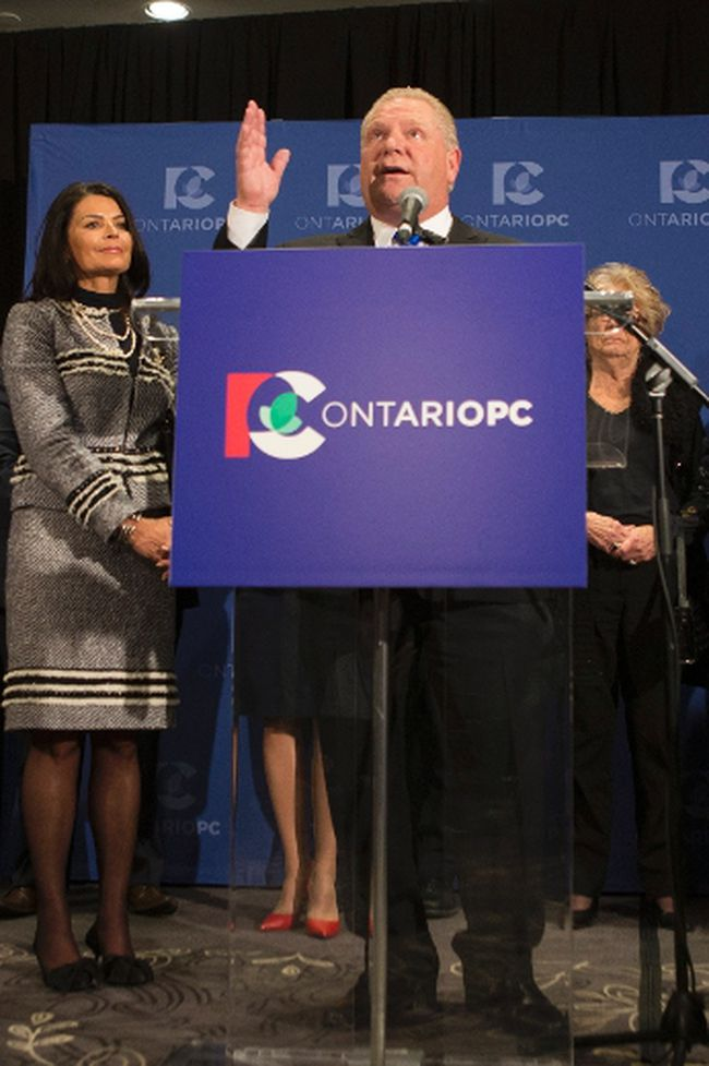 Doug Ford recalls the name of his brother Rob Ford as he stands at the podium after being named as the newly elected leader of the Ontario Progressive Conservatives. (The Canadian Press)