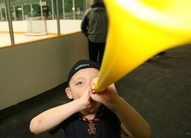 Peyton Tost of Rama, Ont., blows a horn for his team at the Little Native Hockey League tournament in Sudbury, 2012. Postmedia File Photo