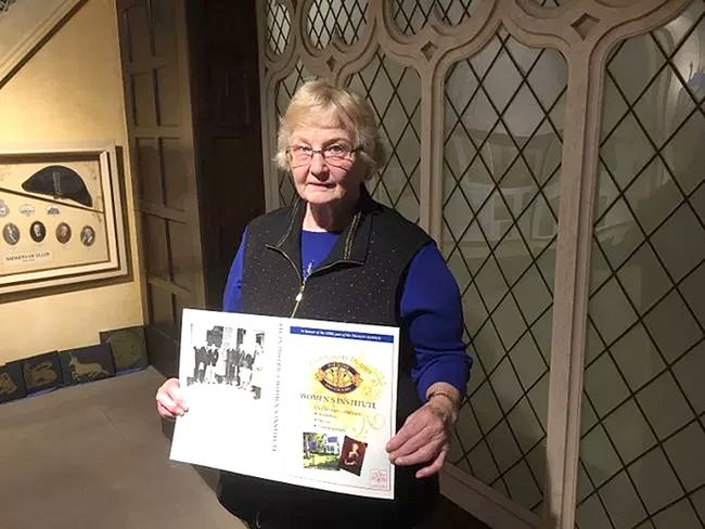 Mary Clutterbuck of the Elgin District Women's Institute holds a mock-up of the front cover to the new book that chronicles the history of the area through stories from members of the organization. The book will be formally launched on March 19. Laura Broadley/Postmedia Network