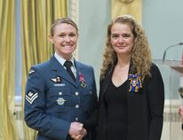 Master Cpl. Alisha St. George accepts a Medal of Bravery from Governor General Julie Payette on March 11.