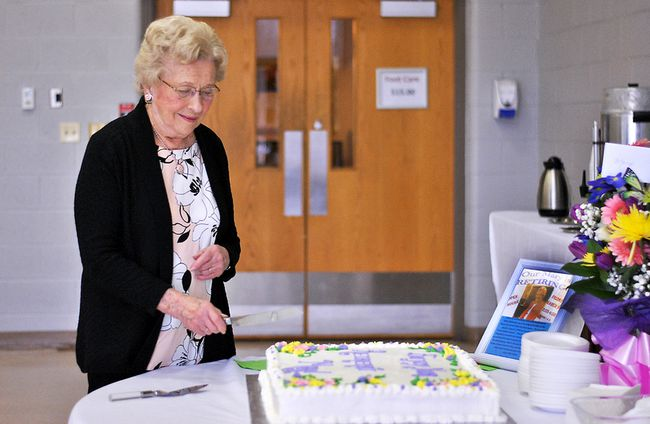 Mary McDonnell, the last founding member of the Active Lifestyle Centre, cuts the cake at her retirement party. She has worked at the centre in all three of its incarnations since 1970. (Tom Morrison/Postmedia Network)