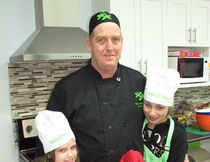 <p>Clint Crites, nutrition co-ordinator at the Boys & Girls Club of Cornwall/SDG, in the kitchen area at the Henry Street Clubhouse, with March Break campers Brady McCormick (left) and Isabella Rogers, on Monday, March 12, 2018, in Cornwall, Ont.</p><p> Todd Hambleton/Cornwall Standard-Freeholder/Postmedia Network