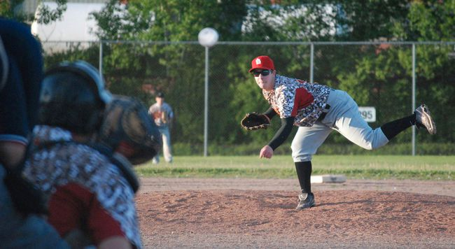Ryan Scott delivers a pitch at the Veterans Park diamond in June 2014. Nugget File Photo