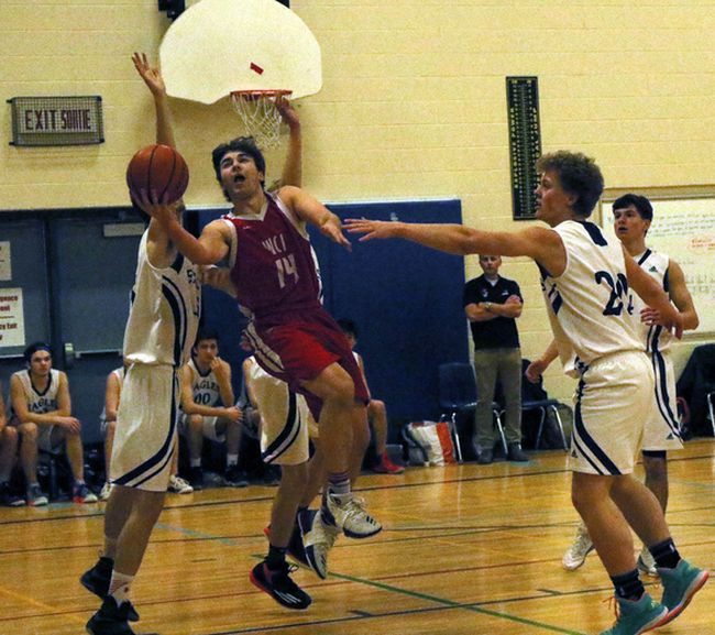 Woodstock Collegiate Institute's Callaghan Bullen, centre, drives the lane for a layup against Clinton's St. Anne's in London, Ont. on Thursday February 22, 2018 during their 'A' senior boys' WOSSAA basketball final. WCI won silver. Greg Colgan/Woodstock Sentinel-Review/Postmedia Network