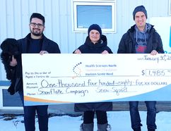 Bello the dog, Mitch Gammon, left, general manager of Snow Squad, Sally Dunton, manager of community engagement at the HSN Foundation, and Taylor Marshall, owner of Snow Squad, take part in a cheque presentation. Supplied photo