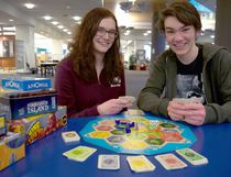 Project Play volunteers and London Library staff members celebrate the introduction of board game lending following a donation of more than 170 games. (Photo submitted)