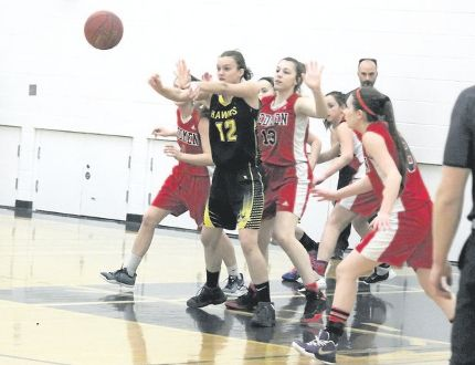 Hanna Hawks' Alexi Stromsmoe passes the ball during the South Central 2A zone gold-medal game in Hanna on Saturday. The Hawks defeated Acme 50-28 sending them to provincial championship in Cardston, beginning today (Wednesday). Misty Hart/ Hanna Herald