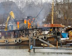 This was the view from the Port Dover Yacht Club Wednesday as a derelict tug boat in the Harry Gamble Shipyard caught fire and burned. Norfolk Fire & Rescue had the situation under control about 90 minutes after the alarm was called in. MONTE SONNENBERG / SIMCOE REFORMER