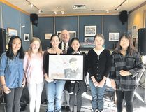 Banff students Amber De Leon, Clare Carswell, Liv Jensen, Wako Odagiri, Tasha Scurfield, and Jessie Huang with Banff Legion president Bruce McTrowe at Saturday's Legion Poster and Literary Contests awards ceremony. Spencer Van Dyk/ Crag & Canyon