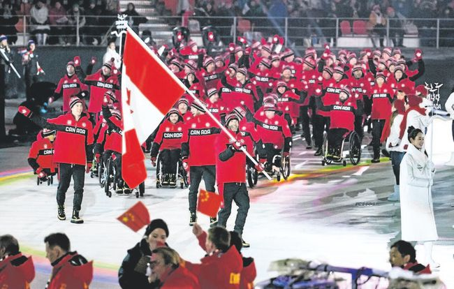 Canmore's Brian McKeever leads Canada into the opening ceremonies of the Pyeongchang Paralympics on Friday, March 9, 2018. Canadian Paralympic Committee