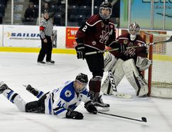 London Nationals captain Brenden Trottier hits the ice hard after trying to drive to the net with Chatham Maroons defenceman Dakota Bohn and goaltender Ryan Wagner during Game 1 of their GOJHL Western Conference semifinal series at the Western Fair Sports Centre in London, Ont., on Wednesday, March 14, 2018. MORRIS LAMONT/THE LONDON FREE PRESS /POSTMEDIA NETWORK