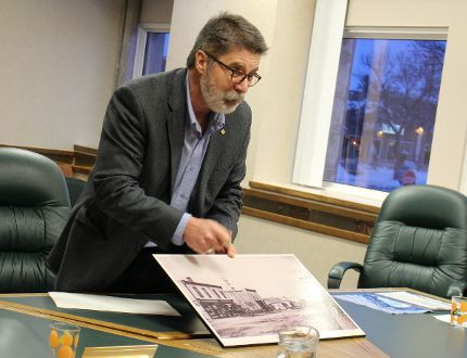 Jimm Simon, with Community Living Interlake, shows council an old picture of the town (prior to 1910) and indicates the future site of the town office, during the Town of Stonewall's regular council meeting March 7. (Juliet Kadzviti/Interlake Publishing/Postmedia Network)