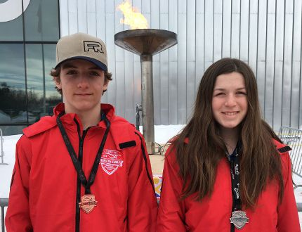 Jared Friesen and Lori Steppler pose with their medals.