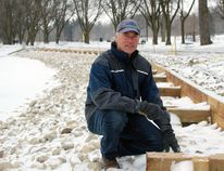 Upper Thames River Conservation Authority conservation services specialist Craig Merkley kneels along the new crib wall installed along the south shore of Lake Victoria on Friday, March 16, 2018 in Stratford, Ont. Terry Bridge/Stratford Beacon Herald/Postmedia Network