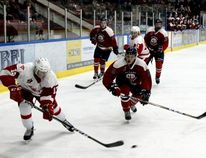 Sean Chase/Daily Observer Pembroke's Noah Maika (#13) steals the puck from Ottawa's Michael Thomas (#5) during the first period at the Pembroke Memorial Centre Friday night. The Senators defeated the Kings 5-2 to take game two of the quarter-final series.