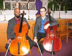 Jack Evans/For The Intelligencer Cellists Amahl Arulanandam, left, and Bryan Holt pose in the sanctuary of St. Thomas Anglican Church prior to their hugely successful concert Sunday afternoon.