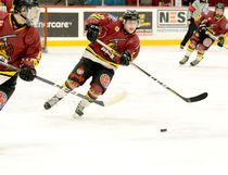 Timmins Rock forward Wayne Mathieu, centre, shown here leading a rush up ice with Derek Seguin, left, and Frederic Leclair-Pouw during Game 2 of the NOJHL quarterfinal series against the Hearst Lumberjacks at the McIntyre Arena on March 12, has been named one of Eastlink TV's Playoffs 3 Stars of the Week for the period ending March 18, along with teammate Jared Hester. Mathieu leads in the NOJHL in playoff goals, with three, and sits second in points, with six, to Blind River Beavers sniper Owen Robinson's seven.  THOMAS PERRY/THE DAILY PRESS