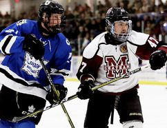London Nationals' Colin Wilson, left, and Chatham Maroons' Dawson Garcia battle in the first period at Chatham Memorial Arena in Chatham, Ont., on Sunday, March 18, 2018. (MARK MALONE/Chatham Daily News/Postmedia Network)