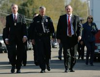 """Bureau of Alcohol, Tobacco, Firearms and Explosives Special Agent in Charge Fred Milanowski, front left, Interim Austin police chief Brian Manley, front center, and FBI Special Agent in Charge Christopher Combs, front right, arrive for a news conference near the site of Sunday's explosion, Monday, March 19, 2018, in Austin, Texas. Fear escalated across Austin on Monday after the fourth bombing this month — this time, a blast that was triggered by a tripwire and demonstrated what police said was a """"higher level of sophistication"""" than the package bombs used in the previous attacks. (AP Photo/Eric Gay)"""