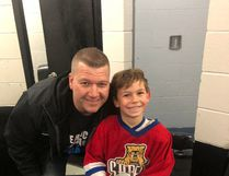 Seven year-old Sarnia hockey player Henry Bulzsa (pictured with Novice Tier 1 Sarnia Red Devils coach Ron Page) was one of ten amateur players from across Ontario to be selected as a Penalty Free MVP by the Hockey Development Centre for Ontario. Handout/Sarnia This Week