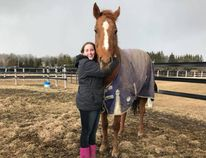 Brenna Parkhill with Diamond Beau, a horse rescued from being slaughtered, raised money with other students to save the former racehorse. (Submitted photo)