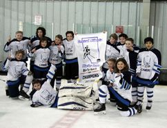 The Canmore Eagles atom A squad celebrates with the CAHL Tier 1 Northwest championship banner after a 6-5 overtime win over the Cochrane Rockies on Tuesday, March 20, 2018. The Canmore Eagles atom AA team won the provincial championship this past weekend. The team includes Leo Johnson, Mackenzie Edwards, Will McLaughlin, Gray Solodan, Issac Riep, Easton Milne, Raine Kapitza, Tyler Deakos, Chase Kjemhus, Yuri Tajima, Griffin Horne, Cade Anderson, Connor MacKenzie, head coach Kyle McLaughlin, assistant coaches Duane Depp, Reid Solodan and Sean Kjemhus, trainer Michael Anderson and manager Kathy Johnson. Russ Ullyot/ Bow Valley Crag & Canyon/ Postmedia Network