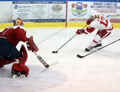 Tina Peplinskie / Daily Observer: Pembroke Lumber Kings's forward Casey Rhodes cuts in towards the Ottawa Junior Senators's net while being watched closely by defenceman Devon Daniels and goalie Connor Hicks during the first period Tuesday night at the PMC. Hicks stopped 30 shots to earn the win in the 4-0 shutout in game 4. Ottawa leads the series 3-1.