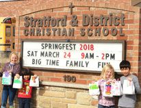 The Stratford and District Christian School is hosting its annual Springfest this Saturday from 9 a.m. to 2 p.m. Pictured, students Mina Visscher, Leland Intarachot, Micah Streutker and Uriah Intarachot show off the hand-decorated mystery bags that will be available for purchase during Springfest. (Galen Simmons/The Beacon Herald)