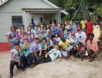 SUBMITTED PHOTO Members of the Nicholson Catholic College mission trip to Kingston, Jamaica over the March Break are pictured with recipient Novalee Ricketts and her family outside the first house the crew built. The Ricketts family were presented with the keys to the home along with a Bible signed by each of the Nicholson team members.