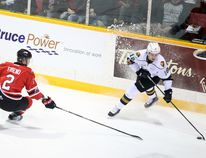 The Knights' Liam Foudy tries to shake Owen Sound's Jacob Friend in the first period of Game 1 of the Owen Sound Attack and London Knights first round Ontario Hockey League playoff series in Owen Sound on Thursday. Greg Cowan/The Sun Times.