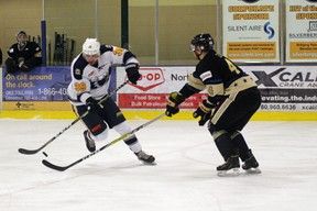 Tyler Maltby works his way around Generals defenceman and captain Don Morrison.  Photo by Josh Thomas.