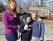 Samantha Lesser, left, stands in the Cancer Survivors Garden in London, Ontario with her children Graham (held), Sophia (middle), and Grace (right). Lesser was diagnosed with Hodgkin's lymphoma in 2012 but was successfully cleared before the end of the year. During that time she relied on the Canadian Cancer Society, which relies on donations during their Daffodil Month every April. (Louis Pin/Times-Journal)