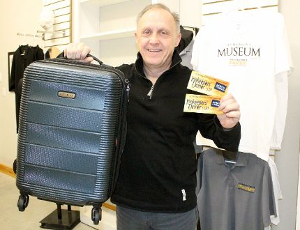 Stratford Perth Museum general manager John Kastner holds up a suitcase filled with items for the auction and tickets for the upcoming Innkeepers' Dinner on Friday, March 23, 2018 in Stratford, Ont. The dinner is on April 21. (Terry Bridge/Stratford Beacon Herald)