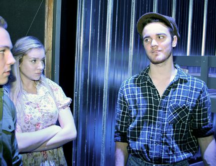 Ryan McColman, as Curley, Christie Bascombe, as Curley's wife, and Joe Drinkwalter, as George, are shown in a scene from West Ferris Secondary School's production Of Mice and Men. Submitted Photo