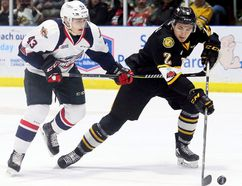 Sarnia Sting's Theo Calvas (2) is chased by Windsor Spitfires' Louka Henault (43) during Game 1 in their OHL Western Conference quarter-final at Progressive Auto Sales Arena in Sarnia, Ont., on Saturday, March 24, 2018. (MARK MALONE/Postmedia Network)