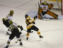 Kingston Frontenacs' Linus Nyman puts a hard shot past North Bay Battalion goaltender Christian Propp to put the Fronts first on the board during the first period of Ontario Hockey League Eastern Conference quarter-final action at the Rogers K-Rock Centre on Sunday.