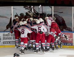 The Colts pile on, after Cameron Hebert's overtime winner. Jeff Derouchie/Special to the Cornwall Standard-Freeholder