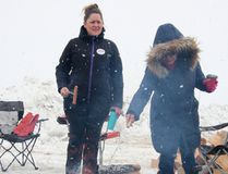 KASSIDY CHRISTENSEN HIGH RIVER TIMES/POSTMEDIA NETWORK. Kelly Lopaschuk, left, and Liz Vigueras, right, roast their hot dogs over the bonfire.