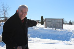 Councillor Claude Bourassa, chairman of the Cemetery Committee, points to his choice of niche in the Town's newly delivered columbarium. The niches will go on sale shortly and provide residents an alternative to a regular plot.
